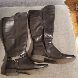 Very used black knee high boots for materials